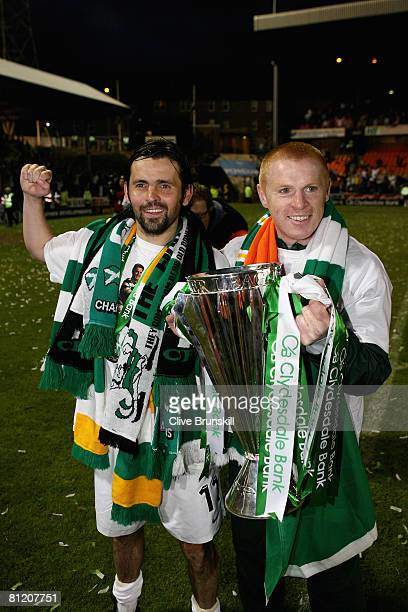Paul Hartley and Neil Lennon of Celtic celebrate with the Scottish Premier League Trophy during the Clydesdale Bank Premier League match against...