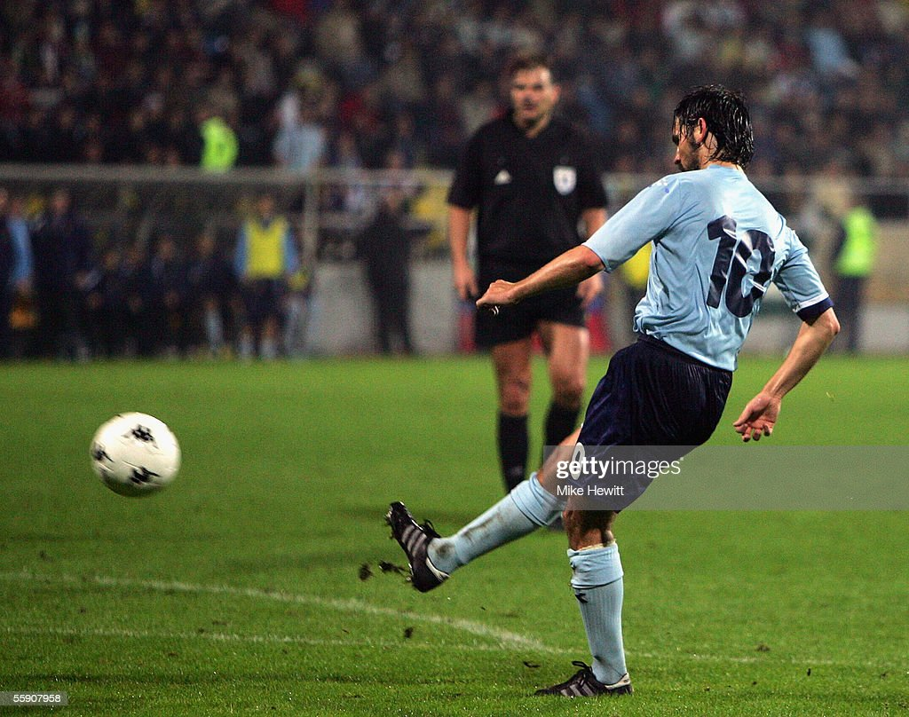 Paul Hartley of Scotland calmly lobs in his team's third goal during the FIFA World Cup group 5 qualifying match between Slovenia and Scotland on October 12, 2005 at the Petrol Arena Stadium in Celje, Slovenia.