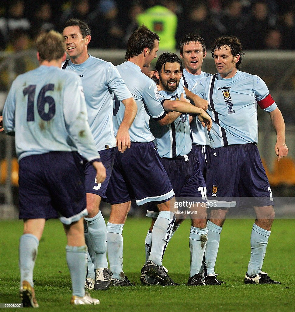 Paul Hartley of Scotland celebrates with team-mates after scoring the third goal during the FIFA World Cup group 5 qualifying match between Slovenia and Scotland on October 12, 2005 at the Petrol Arena Stadium in Celje, Slovenia.