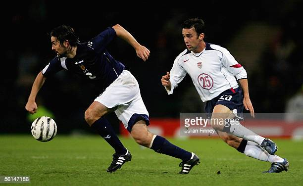 Paul Hartley of Scotland moves away from Kerry Zavagnin of USA during the international friendly match between Scotland and USA at Hampden Park on...