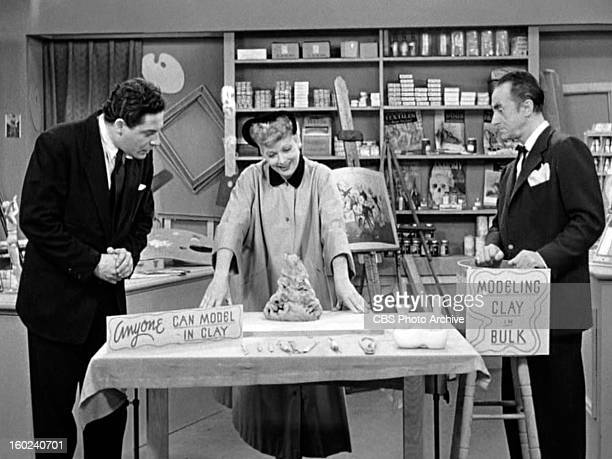 Paul Harvey as Mr Harvey Lucille Ball as Lucy Ricardo and Leon Belasco as the art shop clerk in the I LOVE LUCY episode Lucy Becomes a Sculptress...