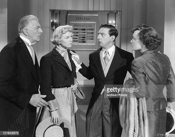 Paul Harvey Doris Day Ray Bolger and Eve Miller in confrontation in a scene from the film 'April In Paris' 1952