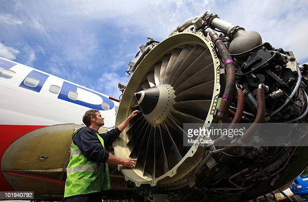 Paul Hatchet, an employee of Air Salvage International, inspects the fan blades on a engine of a 737 600 currently being dismantled on June 9, 2010...