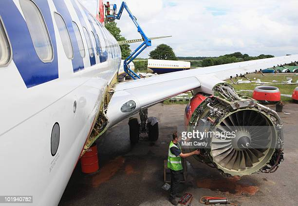 Paul Hatchet ,an employee of Air Salvage International, removes parts from the engine as Stacey Bewick removes panels on the tail of a 737 600...
