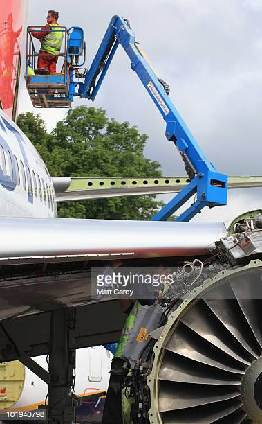 Paul Hatchet ,an employee of Air Salvage International, removes parts from the wing as Stacey Bewick removes panels on the tail of a 737 600...