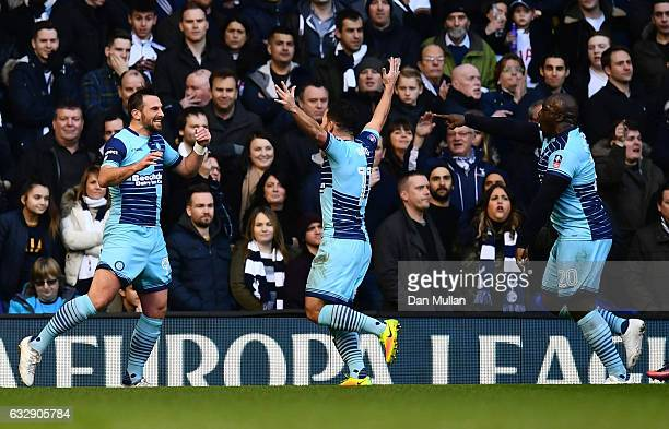 Paul Hayes of Wycombe Wanderers celebrates scoring the opening goal with his team mates during the Emirates FA Cup Fourth Round match between...