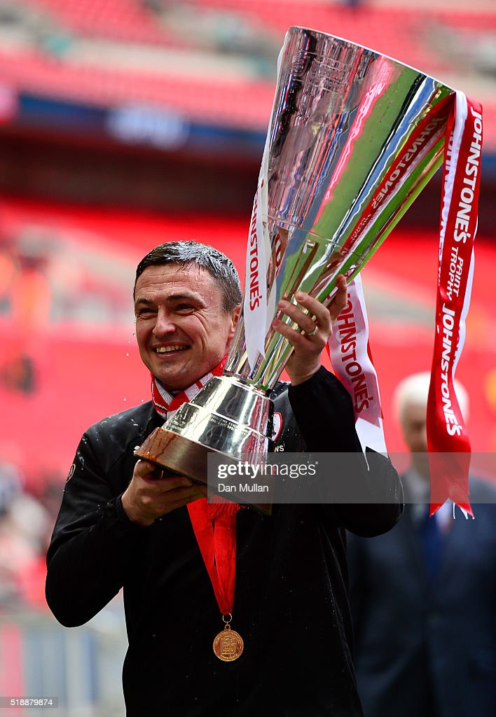 Paul Heckingbottom, Caretaker Manager of Barnsley celebrates with the trophy following his side's victory during the Johnstone's Paint Trophy Final between Oxford United and Barnsley at Wembley Stadium on April 3, 2016 in London, England.