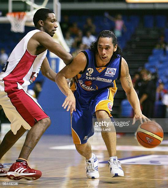 Paul Henare of the Breakers dribbles past Cortez Groves of the Hawks during the round 16 NBL match between the New Zealand Breakers and the...