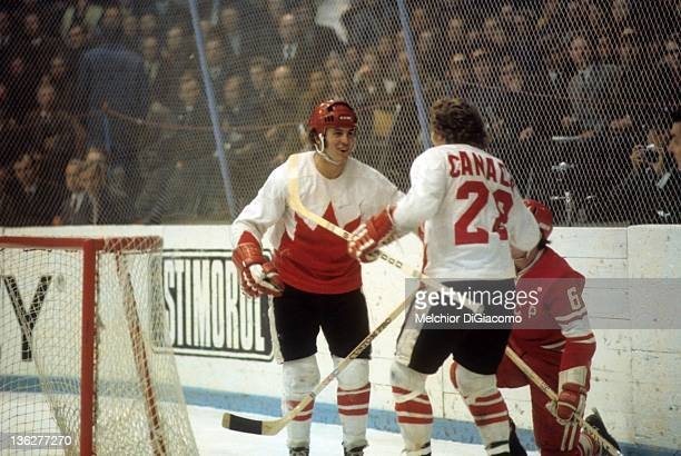 Paul Henderson and Bobby Clarke celebrate Henderson's game winning goal behind the net during Game 7 of the 1972 Summit Series against the Soviet...