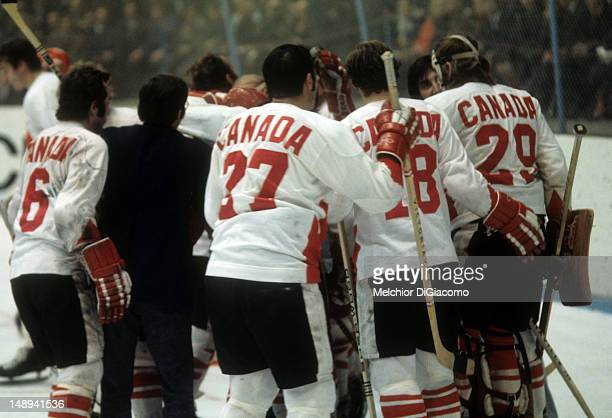 Paul Henderson of Canada is surrounded by celebrating teammates after scoring the serieswinning goal during Game 8 of the 1972 Summit Series between...