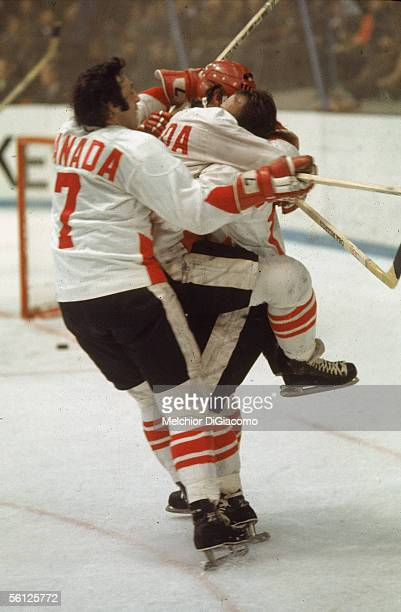 Paul Henderson of Canada jumps in the arms of Yvan Cournoyer as Phil Esposito joins in as they celebrate Henderson's serieswinning goal in Game 8 of...