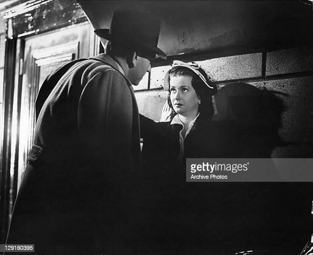 Paul Henreid corners Joan Bennett against wall in a scene from the film 'Hollow Triumph' 1948