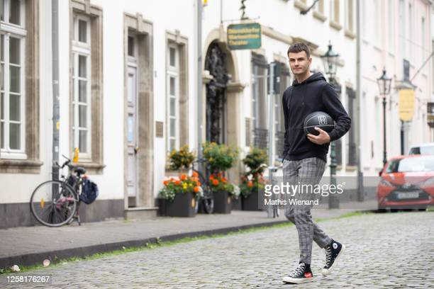 Paul Henry Duval wearing by Comme des Garcons x Converse shoes, boohoo men pants, Arket hooded sweatshirt, Chanel 2004 limited edition Basketball,...