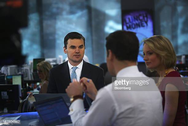 Paul Hickey cofounder Of Bespoke Investment Group LLC left listens during a Bloomberg Television interview in New York US on Thursday April 25 2013...