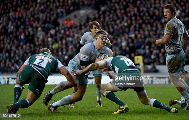 Paul Hill of Northampton is takled by Tom Youngs and Matt Smith of Leicester Tigers during the Aviva Premiership match between Leicester Tigers and...