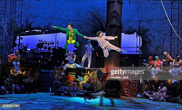 Paul Hilton as Peter Pan and Madeleine Worrall as Wendy with artists of the company in the National Theatre/Bristol Old Vic production of JM Barrie's...