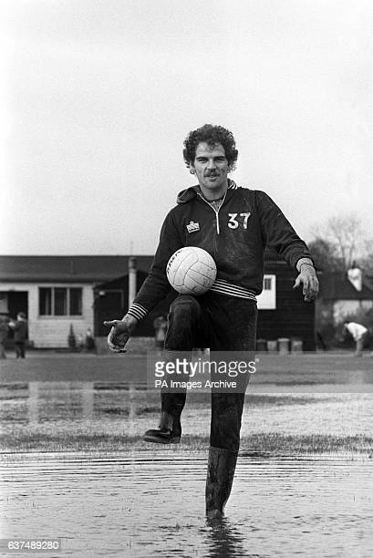 Paul Hinchelwood of Crystal Palace training on a flooded pitch at their training ground following heavy downpours.