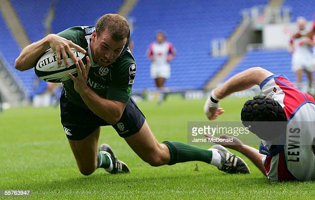 Paul Hodgson of London Irish dives over for a try during the Guinness Premiership match between London Irish and Bristol at The Madejeski Stadium on...