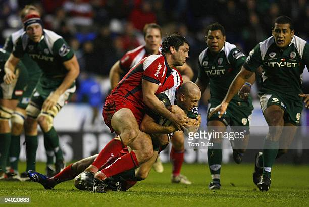Paul Hodgson of London Irish is tackled by Pat Sanderson of Worcester Warriors during the Guinness Premiership match between London Irish and...
