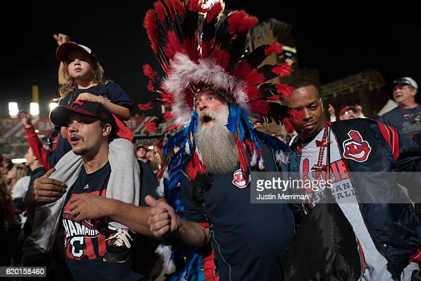 Paul Hollo of Cleveland wears his Indian headgear as he cheers on the Cleveland Indians outside of Progressive Field during game 6 of the World...