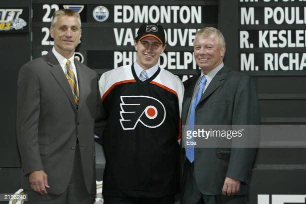 Paul Holmgren first round draft pick Mike Richards Bob Clarke of the Philadelphia Flyers pose for a portrait on stage during the 2003 NHL Entry Draft...