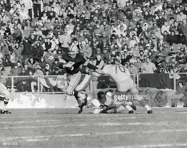 Paul Hornung of the Green Bay Packers carries the ball against Sam Huff and Jimmy Patton of the New York Giants during the 1961 NFL Championship game...