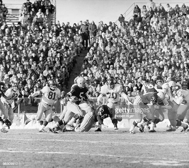 Paul Hornung of the Green Bay Packers carries the ball as Fuzzy Thurston and Jim Taylor block against Tom Scott Andy Robustelli and Sam Huff of the...