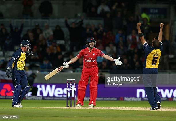 Paul Horton of Lancashire Lightning complains to the umpire after his dismissal with Jeetan Patel of Birmingham Bears celebrating during the Natwest...