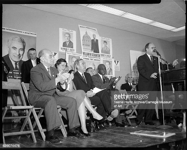 Paul Hugus at podium with microphone in front of Maurice Goldstein Mary Scranton Congressman William 'Bill' Scranton W P Young and Congressman James...