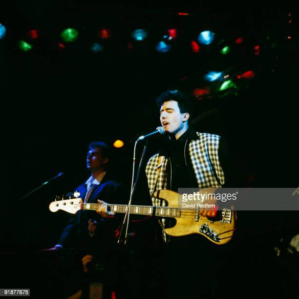 Paul Humphreys and Andy McCluskey of OMD perform on stage circa 1987