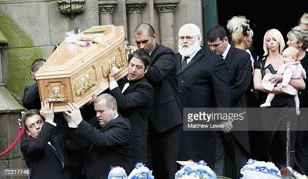 Paul Hunter's coffin is carried by best friend Matthew Stevens, as Lindsey Hunter looks on at Leeds Parish Church on October 19, 2006 in Leeds,...
