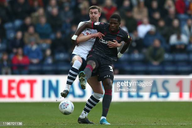Paul Huntington of Preston North End battles for possession with Lucas João of Reading during the Sky Bet Championship match between Preston North...