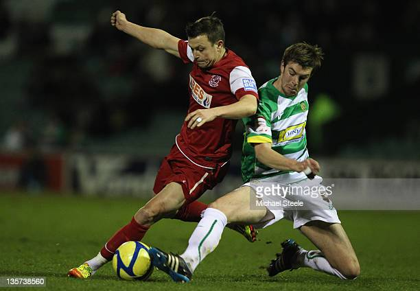 Paul Huntington of Yeovil Town tackles Andrew Mangan of Fleetwood Town during the FA Cup Second Round Replay match between Yeovil Town and Fleetwood...