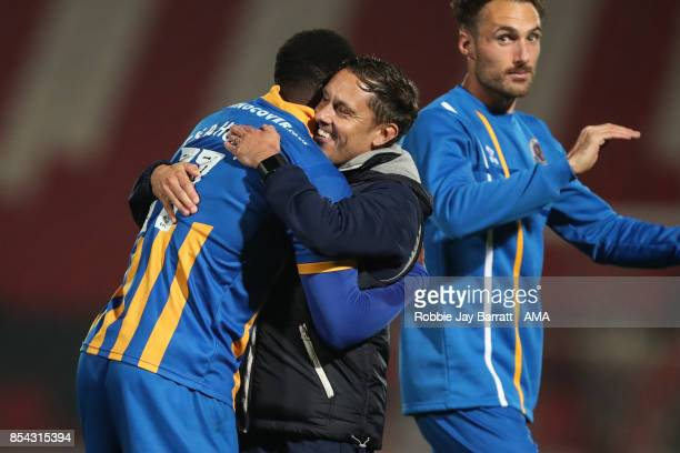 Paul Hurst Manager / Head Coach of Shrewsbury Town and Arthur Gnahoua of Shrewsbury Town celebrate at full time during the Sky Bet League One match...