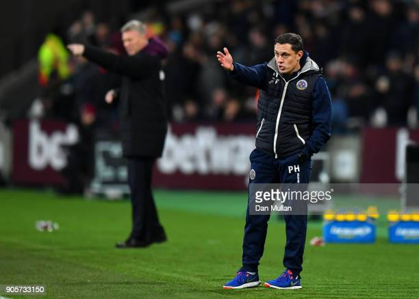 Paul Hurst Manager of Shrewsbury Town gives instructions during The Emirates FA Cup Third Round Replay match between West Ham United and Shrewsbury...