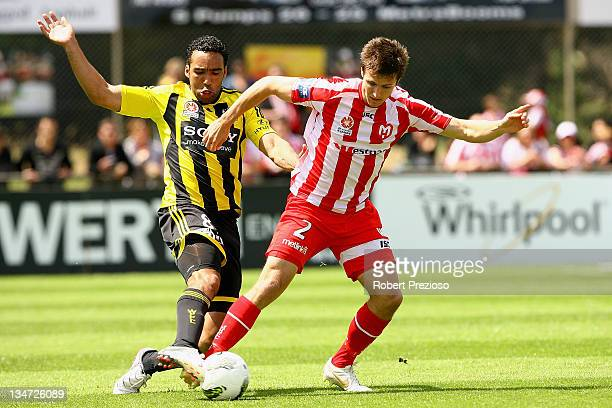 Paul Ifill of the Phoenix and Michael Marrone of the Heart contest the ball during the round nine A-League match between the Melbourne Heart and the...