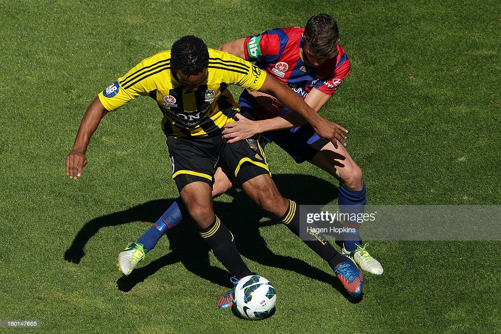 Paul Ifill of the Phoenix is tackled by Scott Neville of the Jets during the round 18 A-League match between the Wellington Phoenix and the Newcastle Jets at Westpac Stadium on January 27, 2013 in Wellington, New Zealand.