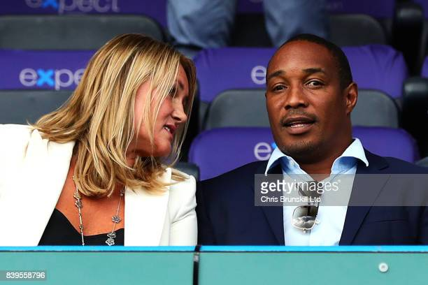 Paul Ince looks on next to his wife Claire during the Premier League match between Huddersfield Town and Southampton at the John Smith's Stadium on...