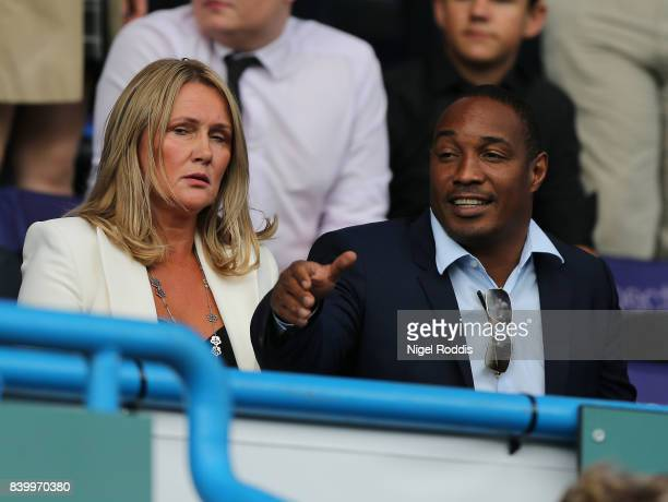 Paul Ince looks on next to his wife Claire during the Premier League match between Huddersfield Town and Southampton at Galpharm Stadium on August 26...