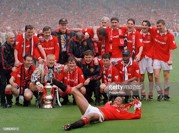 Paul Ince makes a prominent appearance in the Manchester United team photograph after their FA Cup Final victory over Chelsea at Wembley Stadium...