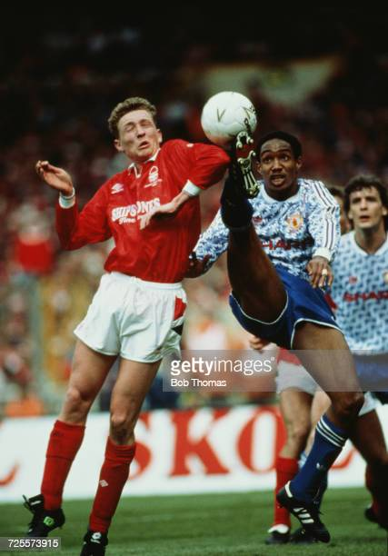Paul Ince of Manchester United is challenged by Scot Gemmill of Nottingham Forest during play in the Rumbelows League Cup Final at Wembley Stadium in...