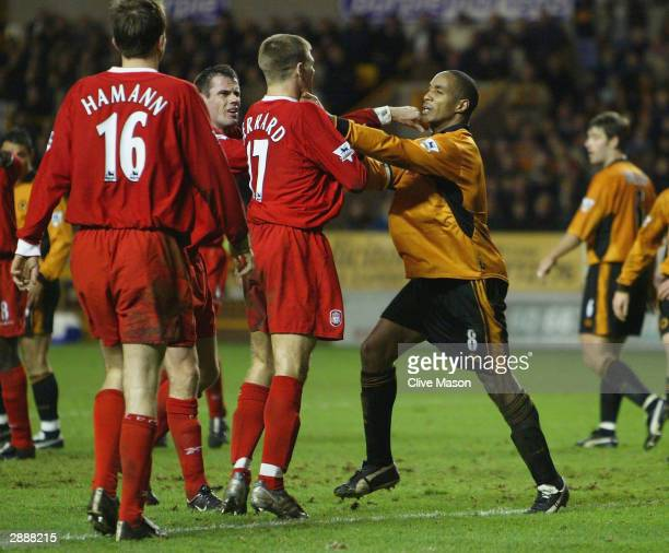 Paul Ince of Wolverhampton Wanderers tussles with Steven Gerrard of Liverpool during the FA Barclaycard Premiership match between Wolverhampton...