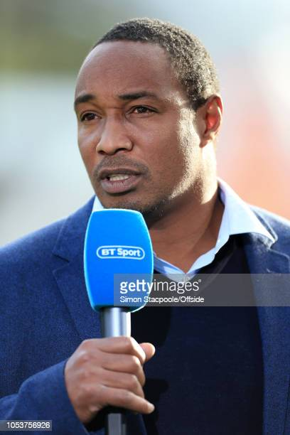 Paul Ince works as a pitchside television pundit for BT Sport during the Premier League match between Huddersfield Town and Liverpool at the John...