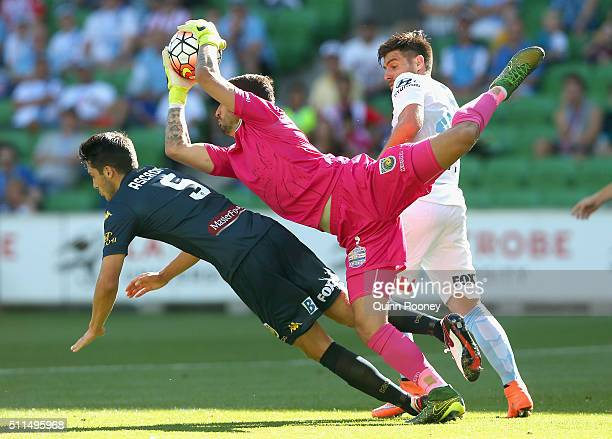 Paul Izzo of the Mariners catches the ball over the top of Ivan Franjic of City during the round 20 ALeague match between Melbourne City FC and the...