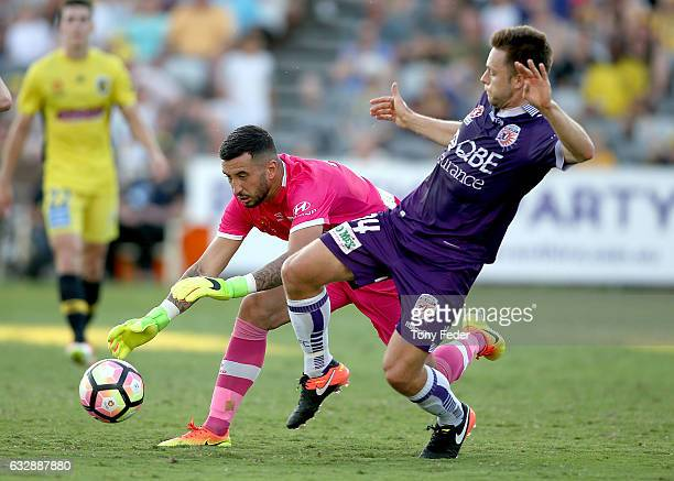 Paul Izzo of the Mariners contests the ball with Chris Harold of the Glory during the round 17 ALeague match between the Central Coast Mariners and...