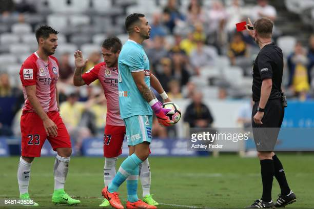 Paul Izzo of the Mariners is shown a red card after colliding with Bruno Fornaroli of Melbourne City during the round 22 ALeague match between the...