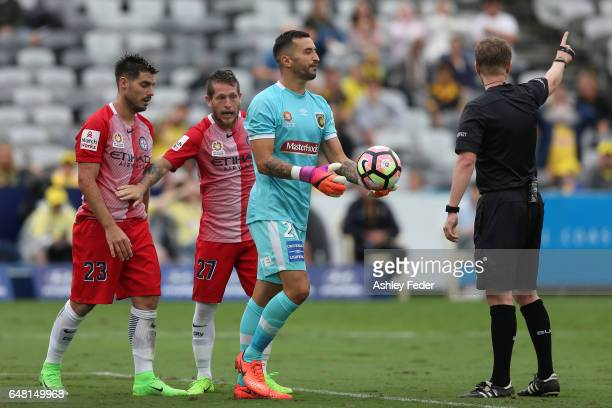 Paul Izzo of the Mariners is shown a red card for colliding with Bruno Fornaroli of Melbourne City during the round 22 ALeague match between the...