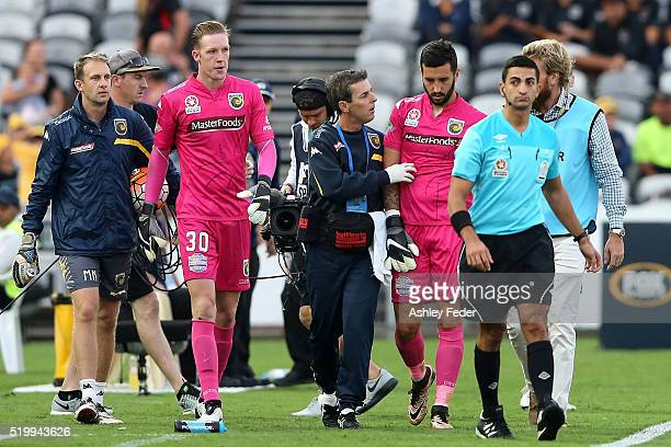 Paul Izzo of the Mariners is walked off the ground injured during the round 27 ALeague match between the Central Coast Mariners and the Newcastle...