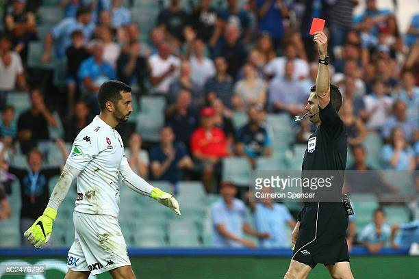 Paul Izzo of the Mariners receives a red card from referee Ben Williams during the round 12 ALeague match between Sydney FC and the Central Coast...