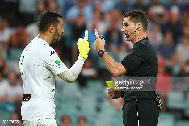 Paul Izzo of the Mariners receives a yellow card from referee Ben Williams during the round 12 ALeague match between Sydney FC and the Central Coast...